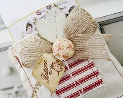 Each bag uses vintage trims teastained tags and fabric